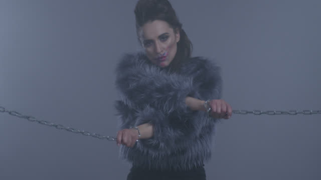 imprisoned with chains brunette high fashion model in fur. fashion video. - prisoner stock videos & royalty-free footage