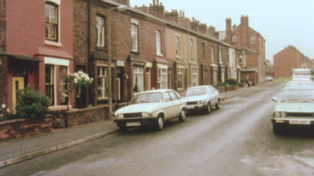 1981 montage improved properties being sold to citizens on a housing waiting list under the 1980 housing act / bolton, manchester, england - manchester england stock videos & royalty-free footage