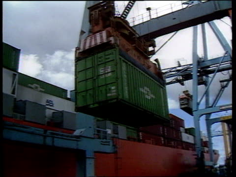 improvement england ms container ship at dockside by cranes la container moved by crane cla another ditto as lowered into hold ms containers by legs... - hochziehen stock-videos und b-roll-filmmaterial