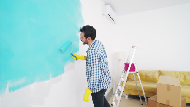 improving my home decoration. - changing color stock videos & royalty-free footage