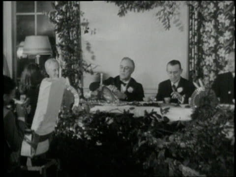 in 1941 us president franklin d roosevelt carves a turkey at a formal thanksgiving dinner in warm springs georgia - thanksgiving politics stock videos & royalty-free footage