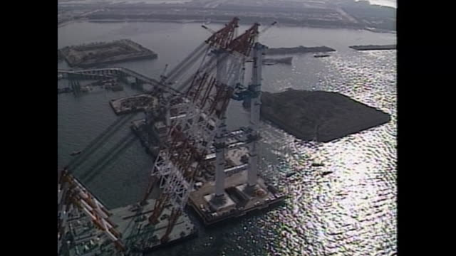 in 1991 a big floating crane worked for building the main tower of rainbow bridge - main tower stock videos and b-roll footage