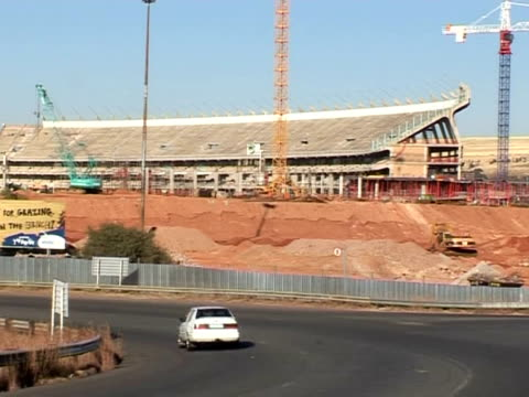 in 2010 south africa will play host to the football world cup. new stadiums are under construction and work is going well, according to fifa... - film montage stock videos & royalty-free footage