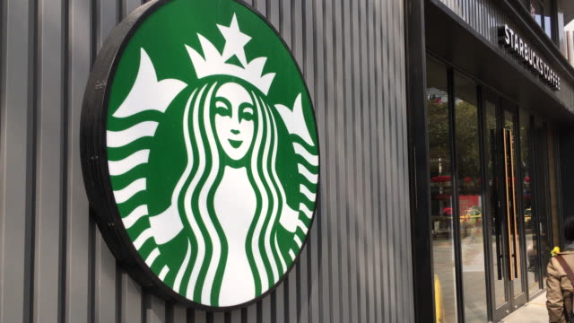 vídeos de stock, filmes e b-roll de in 2017 the revenue of starbucks china rose by 30% and till 2021 the total amount of starbucks coffee shops will arrive at 5000 starbucks is a... - starbucks
