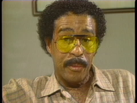 """in a 1982 interview, richard pryor says: """"i don't want to work myself to death. i'm not a workaholic as people say. what i want to do, though, is... - richard pryor comedian stock videos & royalty-free footage"""