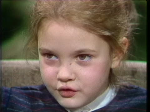 """in a 1983 interview, a 7 year old drew barrymore says: """"they interviewed me for 'poltergeist' first, and she said 'she's not really like the girl... - ドリュー・バリモア点の映像素材/bロール"""