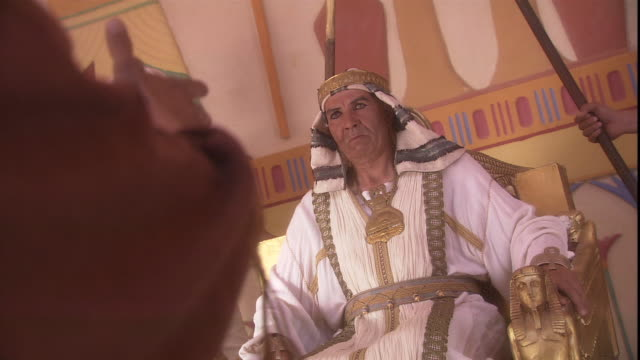 in a biblical reenactment, pharaoh sits on a golden throne and listens as a man makes an appeal to him. - pharaoh stock videos & royalty-free footage