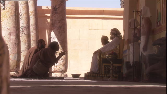 in a biblical reenactment, two men kneel in front of pharaoh and plead with him as he sits on his throne. - north africa stock videos & royalty-free footage
