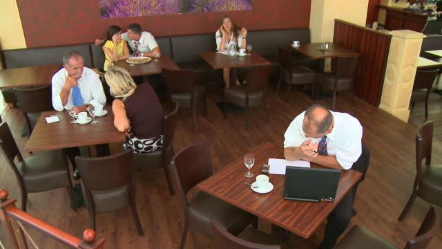 hd crane: in a café - crane shot stock videos & royalty-free footage