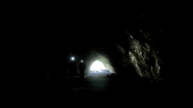 in a cave - electric torch stock videos & royalty-free footage