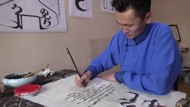 in a classroom in mongolia's capital, students pass over the soviet-era cyrillic alphabet they grew up with and turn their copybooks sideways to... - independent mongolia stock videos & royalty-free footage