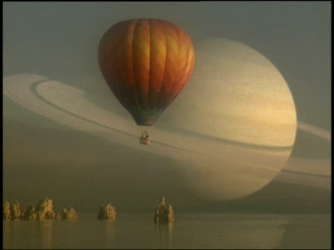 in a computer-generated image, a hot air balloon floats above the surface of titan. - titan moon stock videos & royalty-free footage