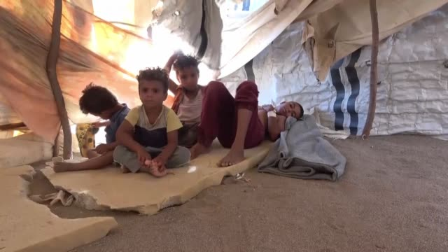 in a desolate camp for yemenis displaced by war, nasima ahmed wonders how she and her four children can possibly protect themselves in the face of... - yemen stock videos & royalty-free footage