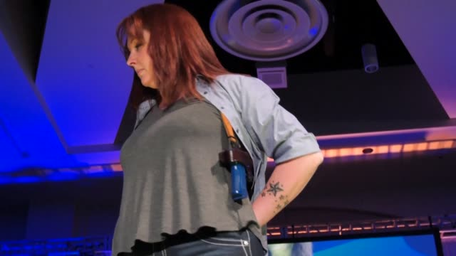 In a distinctly American form of haute couture a runway fashion show showcases a range of accoutrements designed to carry concealed firearms in style