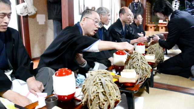 in a february 17 japan ceremony meant to call for a bountiful and healthy year 32 men dressed in traditional formal attire gathered in a house in... - savory food stock videos and b-roll footage