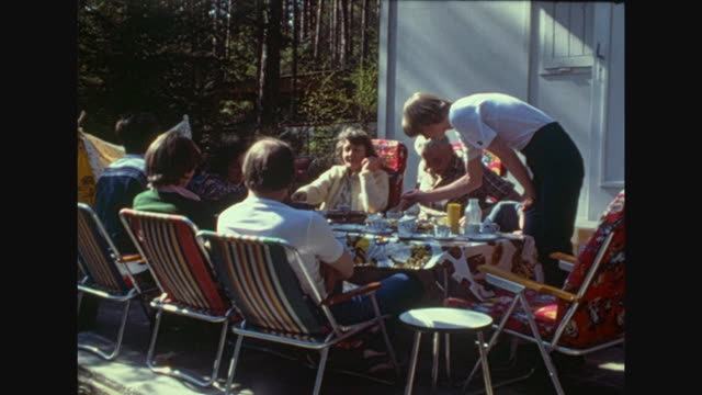 in a garden gdr schrebergarten family party with barbecue kids playing indians with a tepee the little house called datsche is situated near the... - weimar video stock e b–roll