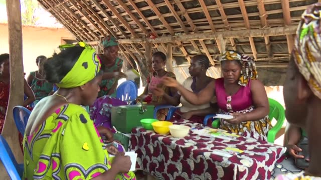 in a poor farming village in ivory coast women are celebrating a new development that is allowing them to send their children to school instead of... - côte d'ivoire stock videos & royalty-free footage