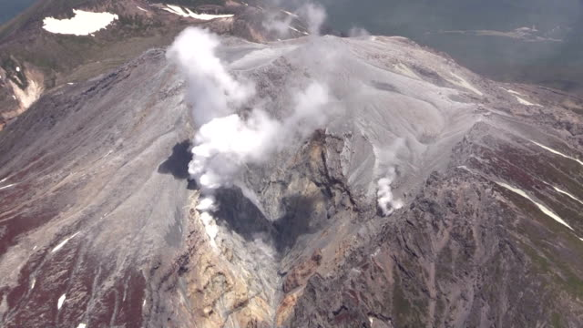 vídeos y material grabado en eventos de stock de in a preliminary step to the resumption of search and rescue operations on mt ontake the scene of a volcanic eruption that killed 57 people and left... - ash