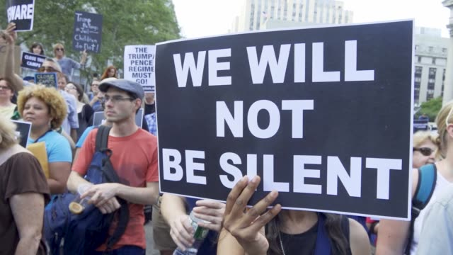 in a rally titled 'lights for liberty' anti president donald trump protesters gathered at foley square in downtown manhattan's civic area demanding... - アメリカ移民税関捜査局点の映像素材/bロール