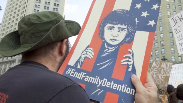 in a rally titled 'lights for liberty' anti president donald trump protesters gathered at foley square in downtown manhattan's civic area demanding... - national border stock videos & royalty-free footage
