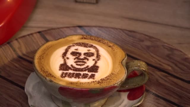 in a self styled anti corruption cafe in kyrgyzstan's capital bishkek people can drink lattes with the portrait of an ex deputy customs chief... - afp stock videos & royalty-free footage
