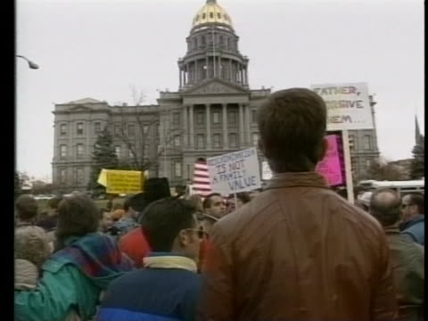 in a sequence of shots, gay rights activists carry signs and protest in front of the colorado state capitol building in denver. - human rights or social issues or immigration or employment and labor or protest or riot or lgbtqi rights or women's rights stock videos & royalty-free footage