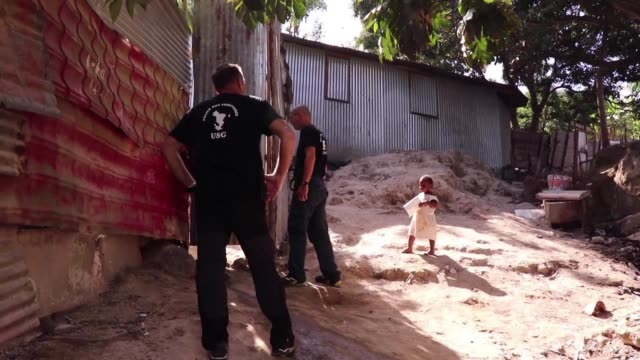 in a slum in petite terre part of france's indian ocean archipelago of mayotte a border police operation sends people fleeing - territori francesi d'oltremare video stock e b–roll