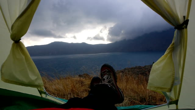 in a tent near the nemrut crater lake with wind, clouds and rain - human limb stock videos & royalty-free footage
