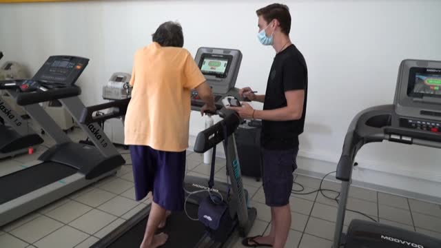 in a town on the outskirts of papeete, treadmills stand next to exercise bikes in a large room, as nine patients from a rehabilitation group, seven... - french overseas territory stock videos & royalty-free footage