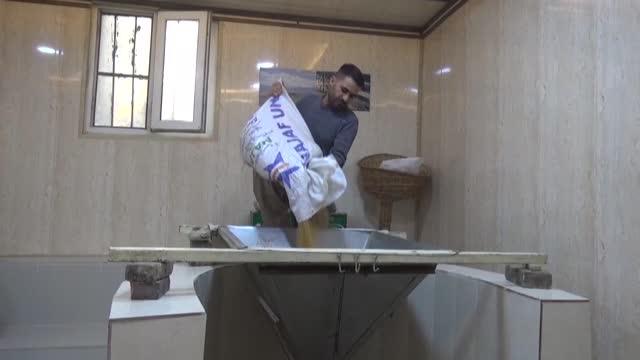 IRQ: Despite modern technology, Iraqi-Kurdish tahini makers stick to tradition