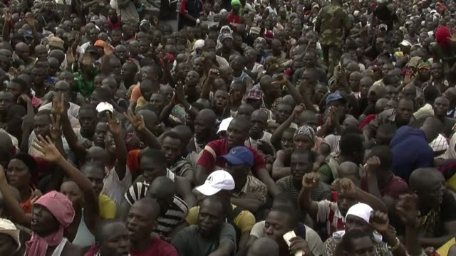 in abidjan thousands of fervent supporters of laurent gbagbo waited to enlist in his defence and security forces after a call to join the fight... - côte d'ivoire stock videos & royalty-free footage