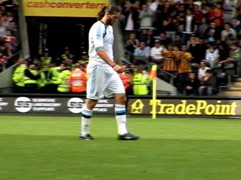 stockvideo's en b-roll-footage met in action for liverpool in a pre-season friendly match against hull city in july 2011. andy carroll at anfield on september 20, 2011 in liverpool,... - vrijetijdsfaciliteiten