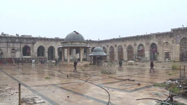 In Aleppo's historic Old City the Syrian army entered the Umayyad Mosque transformed into a battlefield with munitions scattered among the rubble...