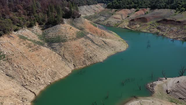 in an aerial view, a truck drives on the enterprise bridge over a section of lake oroville on april 27, 2021 in oroville, california. four years... - california stock videos & royalty-free footage