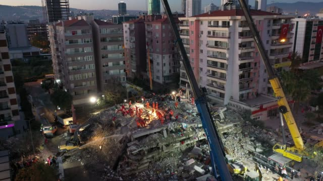 in an aerial view from a drone, emergency services personnel search an eight-story collapsed building for survivors after a powerful earthquake... - kara sea stock videos & royalty-free footage