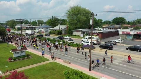 in an aerial view from a drone, supporters of the black lives matter movement walk past ss cyril & methodius roman catholic church on june 06, 2020... - christianity stock videos & royalty-free footage
