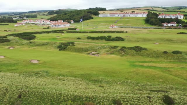 in an aerial view from a drone trump hotel and golf course stands on the pastoral headland along the firth of clyd on july 14 2020 in turnberry... - {{ contactusnotification.cta }} stock videos & royalty-free footage