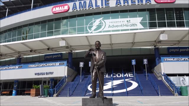 in an aerial view, of the nhl hall-of-famer phil esposito bronze statue stands in honor for his role in co-founding the tampa bay lightning franchise... - gulf coast states stock videos & royalty-free footage