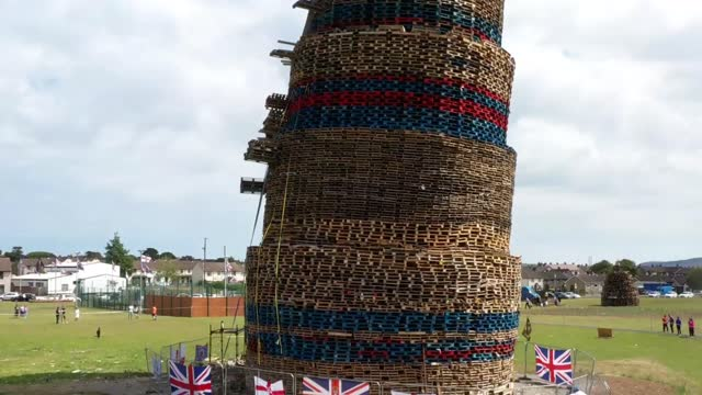 in an aerial view, the craigyhill 11th night bonfire can be seen towering over the estate on july 10, 2021 in larne, northern ireland. the bonfire,... - tall high stock videos & royalty-free footage