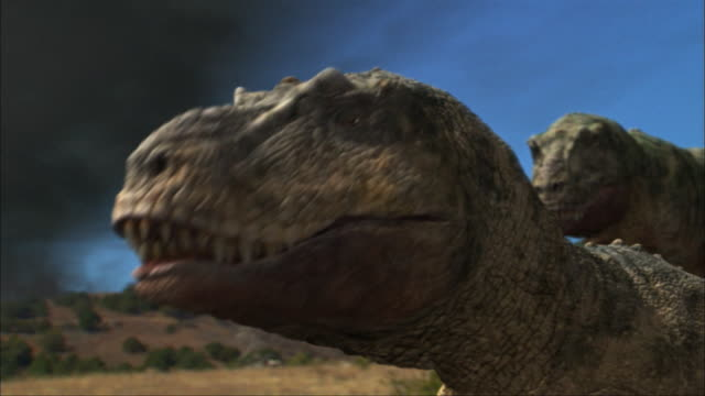 in an animation, tyrannosaurus-rexes watch an exploding volcano. - dinosaur stock videos & royalty-free footage
