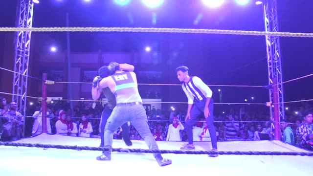 in an egyptian schoolyard hundreds of fans watch as amateur fighters with painted faces and dramatic costumes recreate an american style wrestling... - body adornment stock videos and b-roll footage