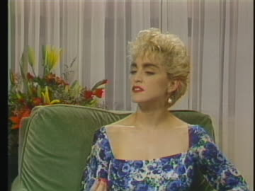 """in an interview, madonna says: """"knowing that you've sold a certain amount of records or so many people have bought this magazine is much different... - music or celebrities or fashion or film industry or film premiere or youth culture or novelty item or vacations stock videos & royalty-free footage"""