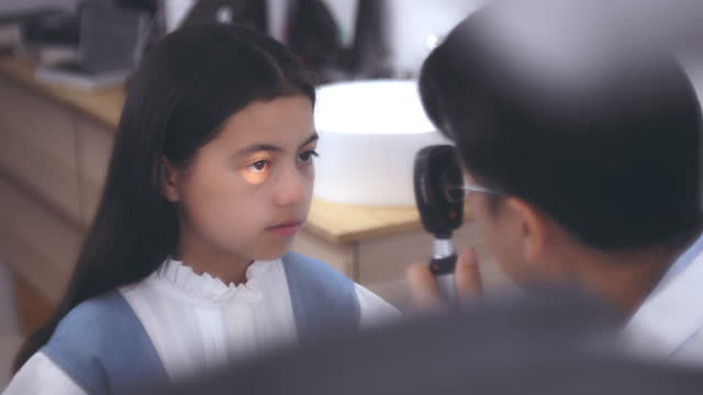 in an optical store , myopia in children - lens optical instrument stock videos & royalty-free footage