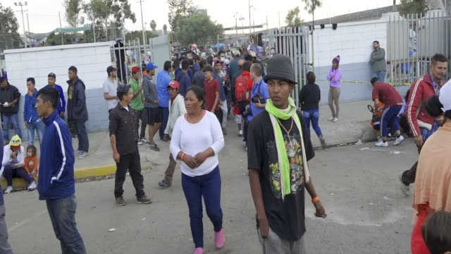stockvideo's en b-roll-footage met in an orderly and systematic way the mexican navy fed the migrant caravan the benito juarez sports complex in tijuana mexico is being used as an... - san diego
