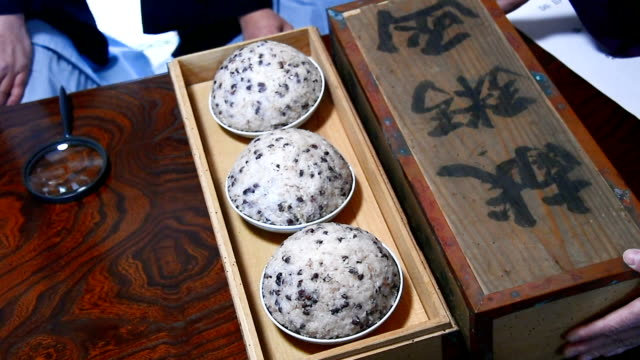 in an unusual divination rite held on feb 1 monks and patrons of aburayama kannon temple in fukuoka cautiously poked sniffed and tasted bowls of... - toccare con un dito video stock e b–roll