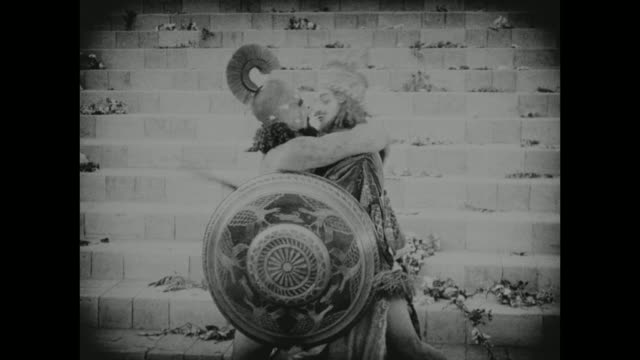 in babylon, two men share a kiss before heading off to battle - babylon stock videos and b-roll footage