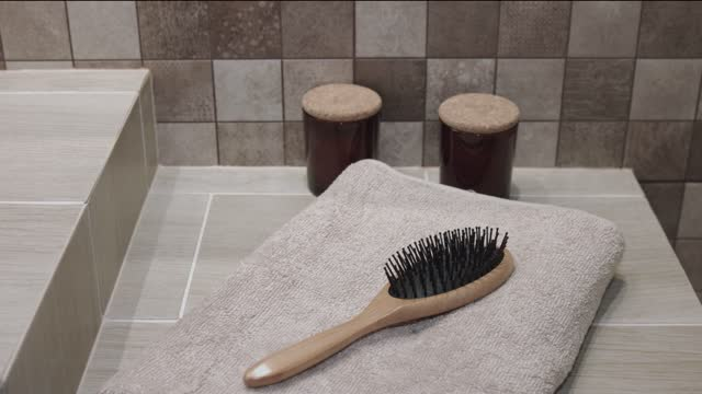 in bathroom hairbrush and towel - hairbrush stock videos & royalty-free footage