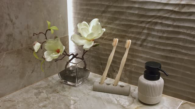 in bathroom toothbrush and soap dispenser - soap dispenser stock videos & royalty-free footage