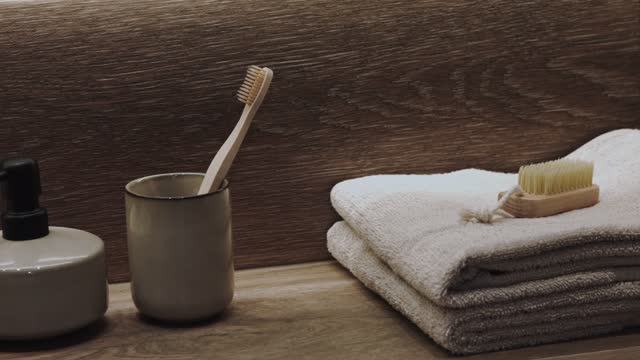 in bathroom toothbrush, soap dispenser, towel, scrubbing brush - soap dispenser stock videos & royalty-free footage