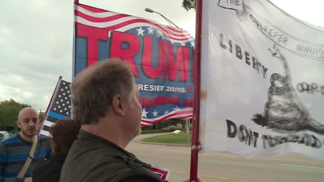 WGN In Bolingbrook Illinois a group calling itself Suburban Families Against Hate demonstrated outside a highdollar Donald Trump presidential...